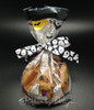 Chocolate chip cookie treats packed in a Halloween cello bag and tied with our ghost ribbon will be a favorite for all trick or treaters!
