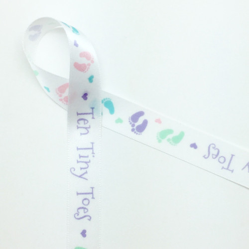 """Ten tiny toes along with pastel footprints on 5/8"""" White Single Face Satin Ribbon"""