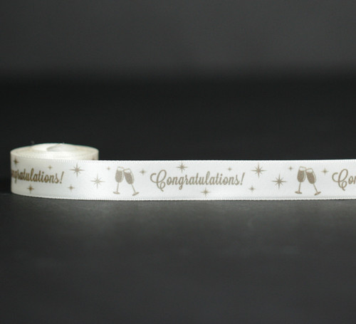 "Congratulations in gold with champagne glasses with stars on 5/8"" antique white satin ribbon, 10 yards"