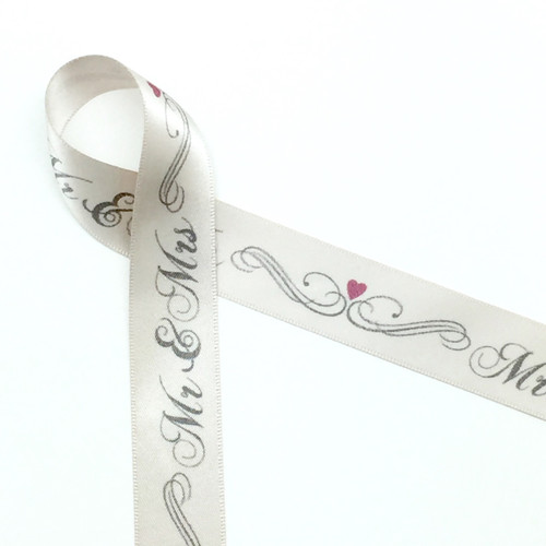 "Mr. & Mrs. with scrolls and hearts on 7/8"" double face satin ribbon on 10 yard spools. Designed and printed in the USA"
