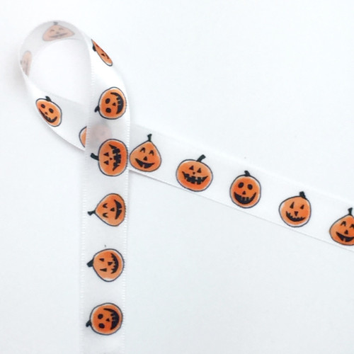 "Pumpkin cuties in a row smiling and having fun on 5/8"" single face satin White ribbon, 10 Yards"