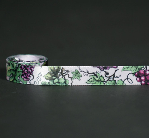 "Grapes and grape leaves on 5/8"" light orchid single face satin ribbon is the perfect addition to any grape themed gift or favor! Designed and printed in the USA"