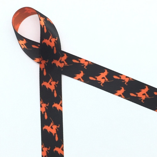 "Witches flying on their brooms in silhouette are the perfect addition to your Halloween Treats. This ribbon is 5/8"" wide printed  on torrid orange single face satin"