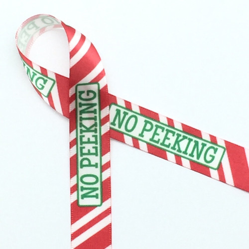 """No Peeking! This fun ribbon is printed with green text on red and white stripes on 5/8"""" white single face satin. Make your small boxes much more interesting with this ribbon!"""