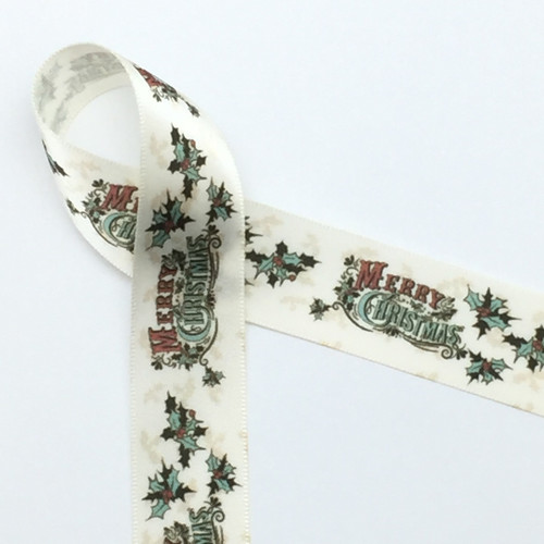"Our vintage Merry Christmas featuring holly leaves in green with red berries on 7/8"" Antique White single face satin ribbon brings back the time of Christmas past. Make your gifts memorable with this lovely vintage accent ribbon!"