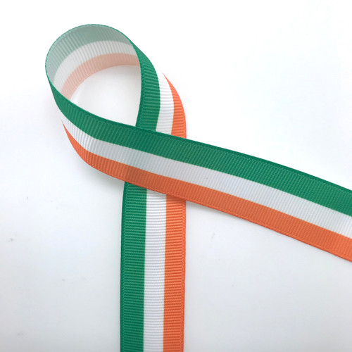 "Green, orange and white stripes on 7/8"" white grosgrain ribbon is a perfect ribbon to celebrate St. Patrick's Day or Irish pride! Designed and printed in the USA"