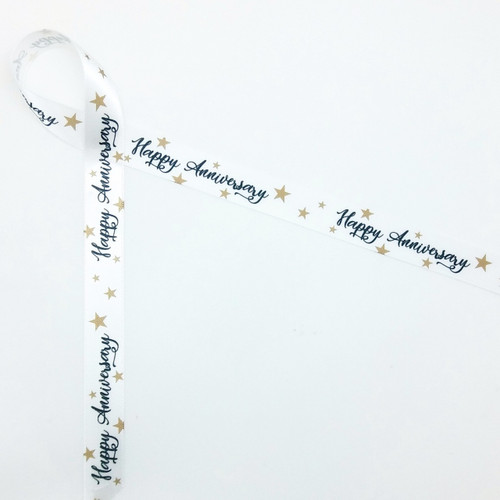 "Happy Anniversary with tossed gold stars in the background on 5/8"" white single face sarin ribbon is an ideal ribbon for gifts and favors at any anniversary celebration!"