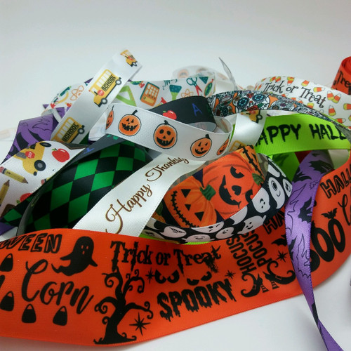"""Our Fall grab bag ribbons is full of our fun Halloween, Thanksgiving, pumpkins and falling leaves designs. Each bag contains 20 yards of our 5/8"""" and 7/8"""" satin and grosgrain ribbon for your Fall projects. Designed and printed in the USA"""