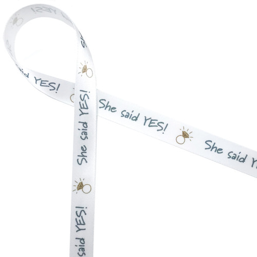 """She said Yes! written in silver with a sparkling gold diamond ring is the perfect ribbon to tie up a little gift for your BFF who just got engaged! This 5/8"""" wide ribbon will be ideal for the party favors too!"""