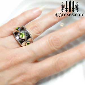 3-wishes-silver-medieval-wedding-ring-gothic-green-peridot-stones-wide-studded-band-model-hand view by 3 rexes jewelry