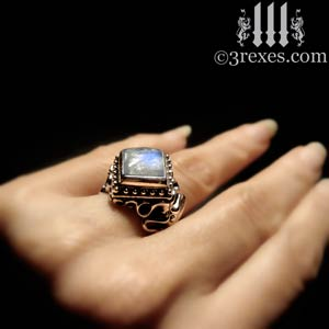 raven-love-engagement-ring-silver-magic-moonstone-hand-model-300.jpg