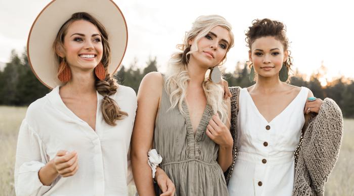 three women linking arms