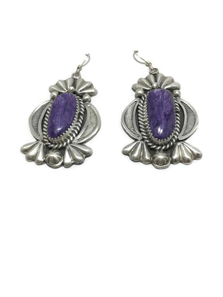 """Navajo made charoite earrings with a makers mark of """"MR""""."""