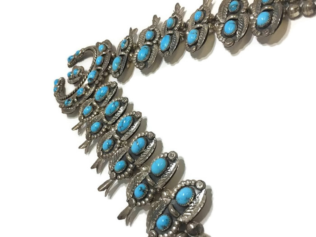 """Navajo old pawn squash blossom necklace with a makers mark of """"W. Haley""""."""