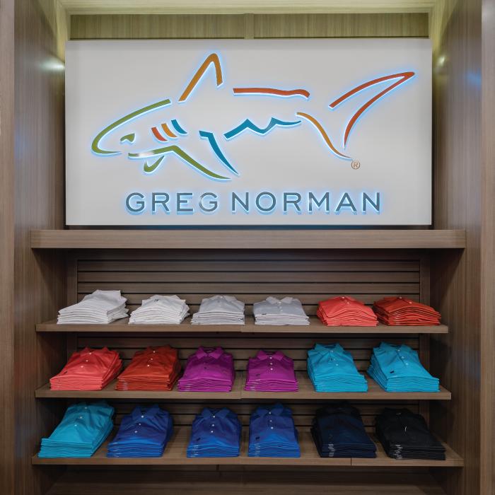 Selection of Greg Norman shirts on shelves