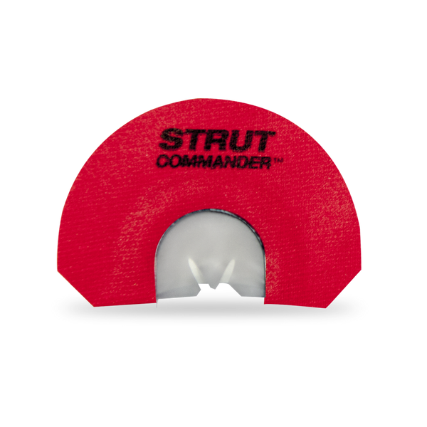 """The Venus Strut Commander mouth / diaphragm call is  a 3 reed,  modified- V cut, call with light rasp and soft to medium volume - made with latex reeds, metal frame and red tape with """"Strut Commander"""" screen printed in black."""