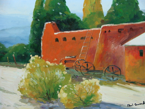 Beautiful small painting on canvas, stretched but without frame, signed by Paul Seward.  Old wagon wheels sit in front of stucco and clay colored buildings with yellow and green shrubs.