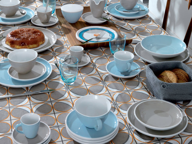 Arzberg Profi light blue full table setting on colorful table linen.