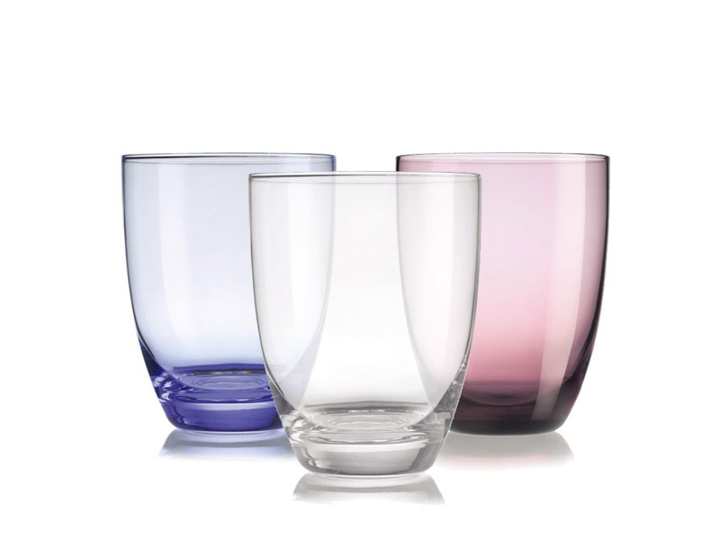 Three Arzberg water glasses in different colors on white background.