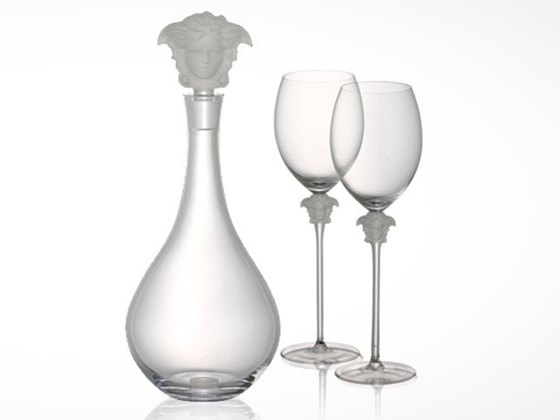 Versace Medusa Lumiere wine glasses and decanter on white background.