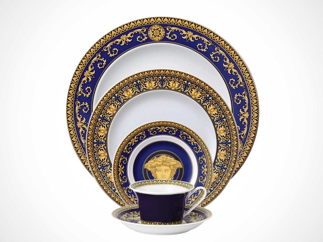 Versace Medusa Blue 5 piece place setting on white background.