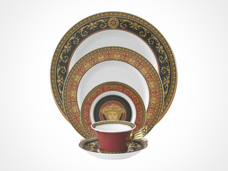 Versace Medusa Red bread and butter plate, salad plate, dinner plate, cup and saucer on white background.