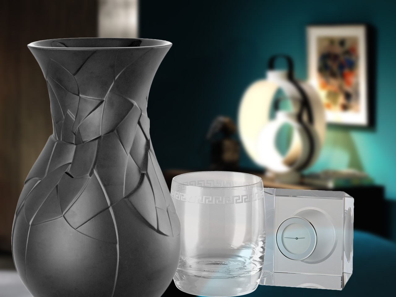 Rosenthal Vases of Phases black vase, Versace Lumiere whiskey tumbler and Rosenthal Block Glass clock efore blured out living room background.
