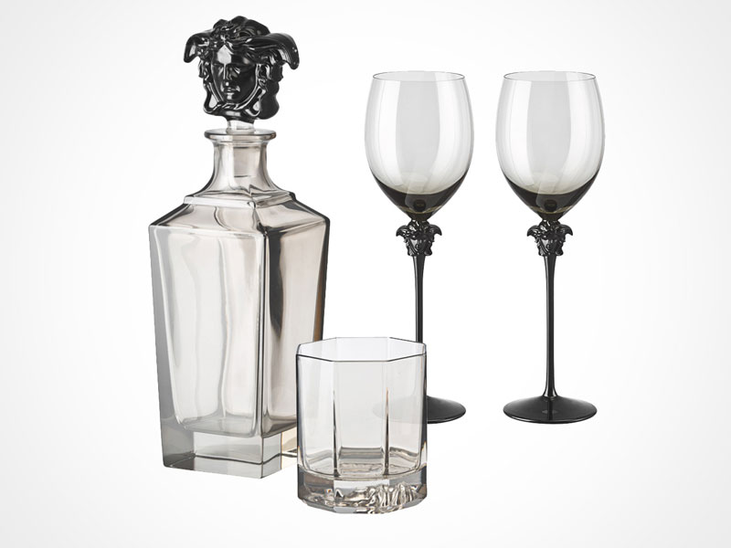 Versace Lumiere Haze bottle and glasses on white background.