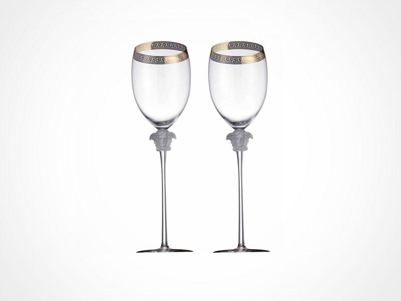 Versace Medusa D'Or wine glasses on white background.