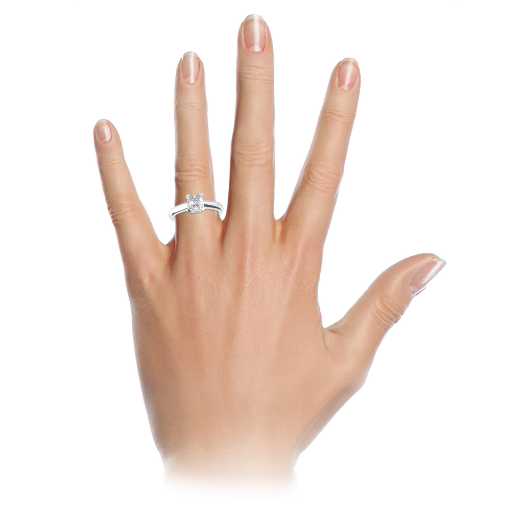 cushion-clawed-4-claw-1-carat-solitaire-18-carat-white-gold-engagement-ring-stylerocks-on-hand