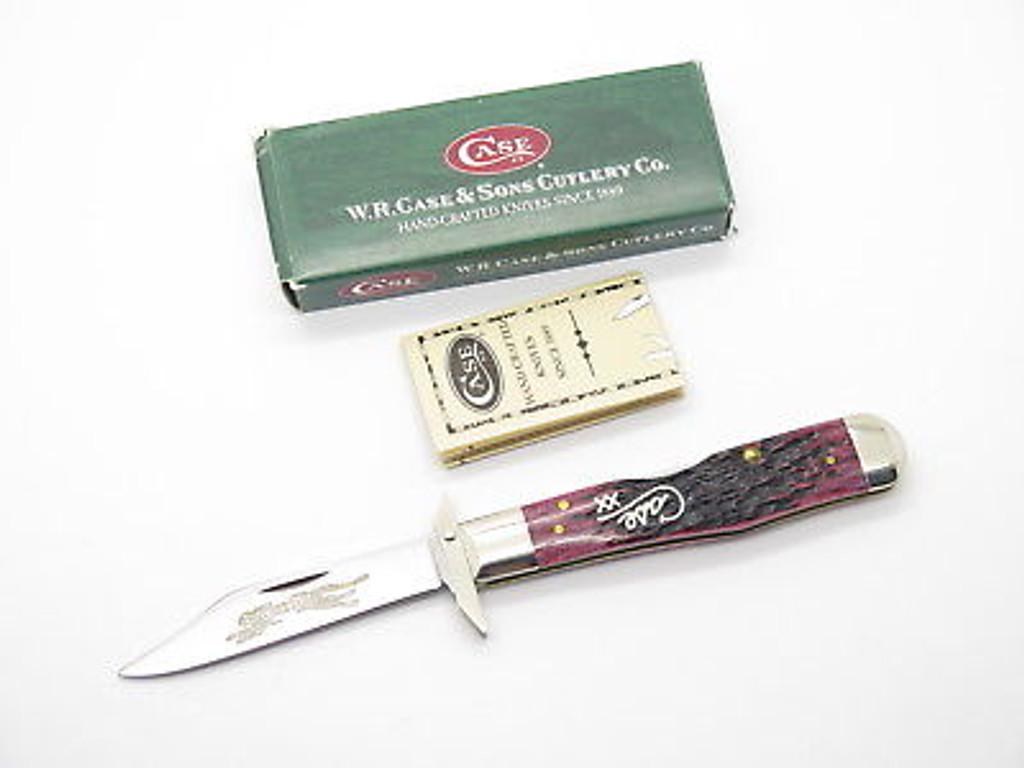 2002 CASE XX 6111 1/2 CHEETAH SCRIPT CRANBERRY SWING GUARD FOLDING KNIFE