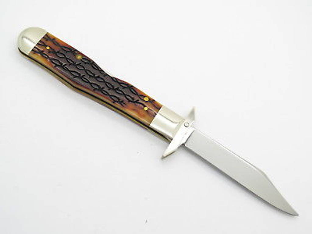 2002 CASE XX 6111 1/2 CHEETAH BARBED WIRE BONE SWING GUARD FOLDING KNIFE