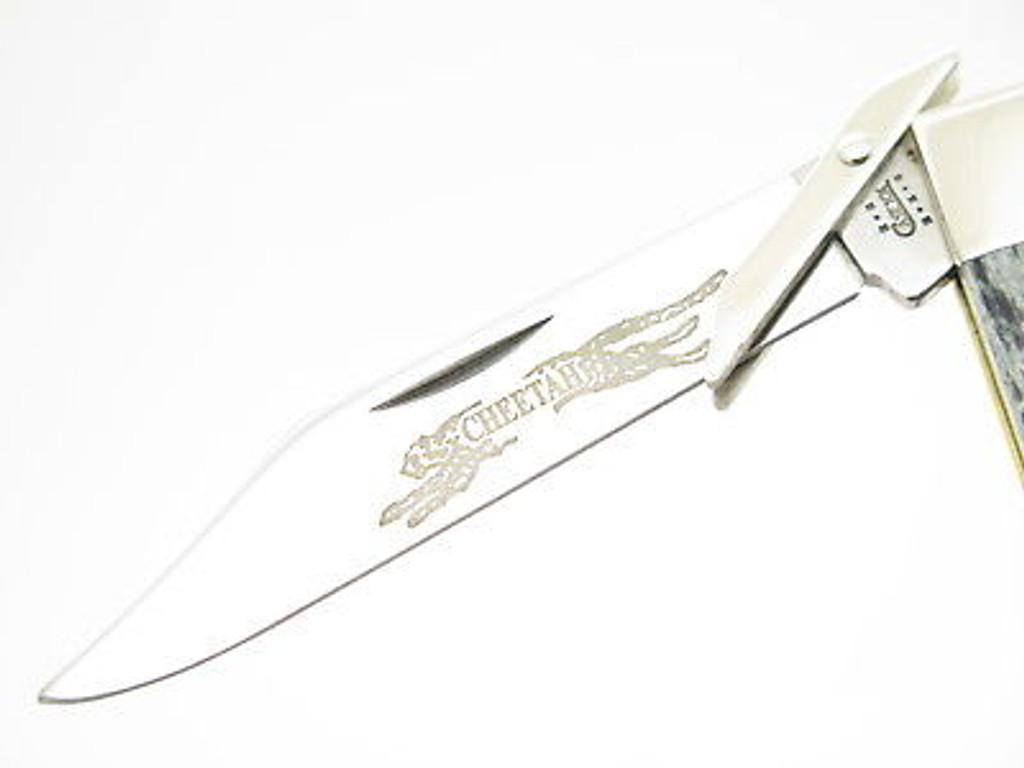 2002 CASE XX 6111 1/2 BLACK BONE CHEETAH SWING GUARD FOLDING POCKET KNIFE