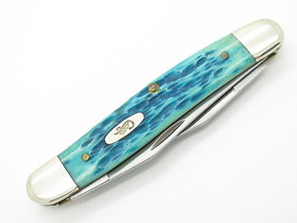 2004 CASE XX MUSKRAT FOLDING POCKET KNIFE CARIBBEAN BLUE JIGGED BONE