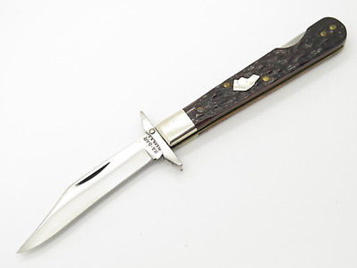 VINTAGE KA BAR CHEETAH SWING GUARD DOG HEAD JIGGED BONE FOLDING POCKET KNIFE