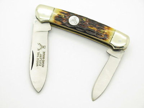 VINTAGE WHITE TAIL CUTLERY HAND MADE JIGGED BONE CANOE FOLDING POCKET KNIFE