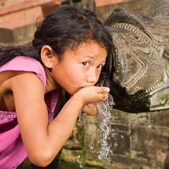 Girl drinking from the fountain of youth
